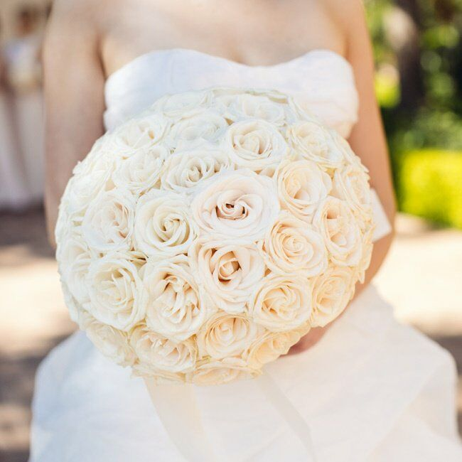 Casey chose cream colored roses for her bouquet to create a classic, timeless look.