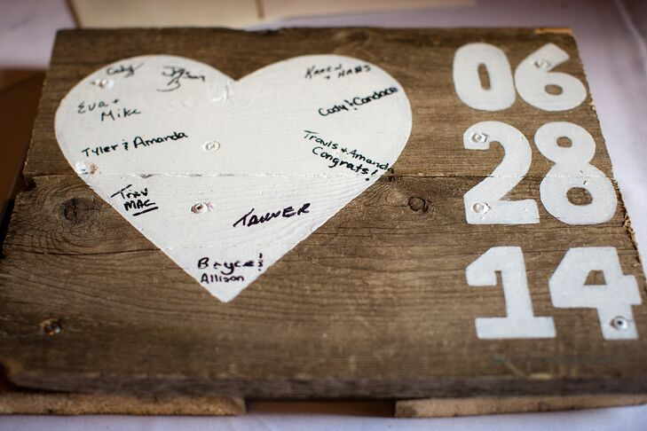 The couple had a painted slice of wood serve as their unique, rustic guest book.