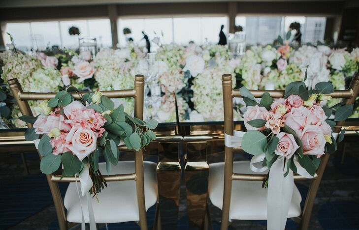 Gold Chiavari Chairs Marked with Roses and Eucalyptus