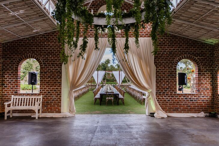 "Katie's favorite part: ""The chandelier inside the barn was dripping in greenery and florals."""
