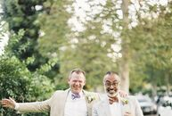 Matt and Paul celebrated their marriage with a cheerful ceremony just down the street from their home, where they hosted the reception in the front ya