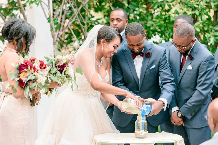 To symbolize their union, the couple incorporated a sand ceremony where they each pour in sand from their homes.