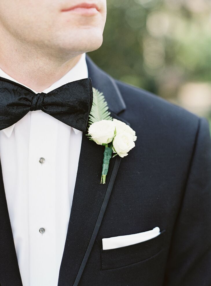 """Matt has great style and truly needed a little help from me with his look for the day,"" Nina says. The groom stuck with a classic black tux paired with a black-on-black paisley bow tie. For a fun pop of hidden color, Matt gave his groomsmen bright, striped Happy Socks."