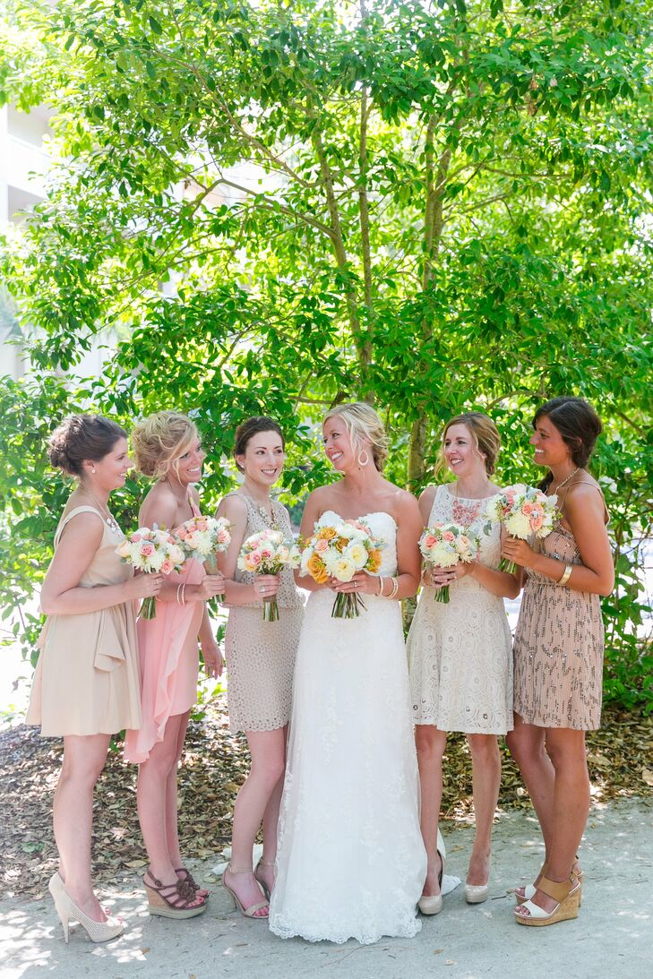 The bridesmaids wore their own blush or champagne colored dresses. Fun statement necklaces completed their look.