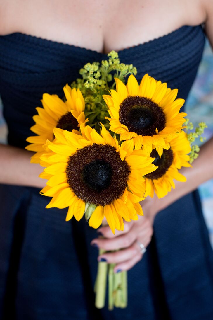 """I picked sunflowers for the ladies because they just have a simplistic beauty that makes me happy,"" says Ashley. "" The men didn't wear boutonnieres because they aren't Dustin's thing and I didn't want anything to look forced."""