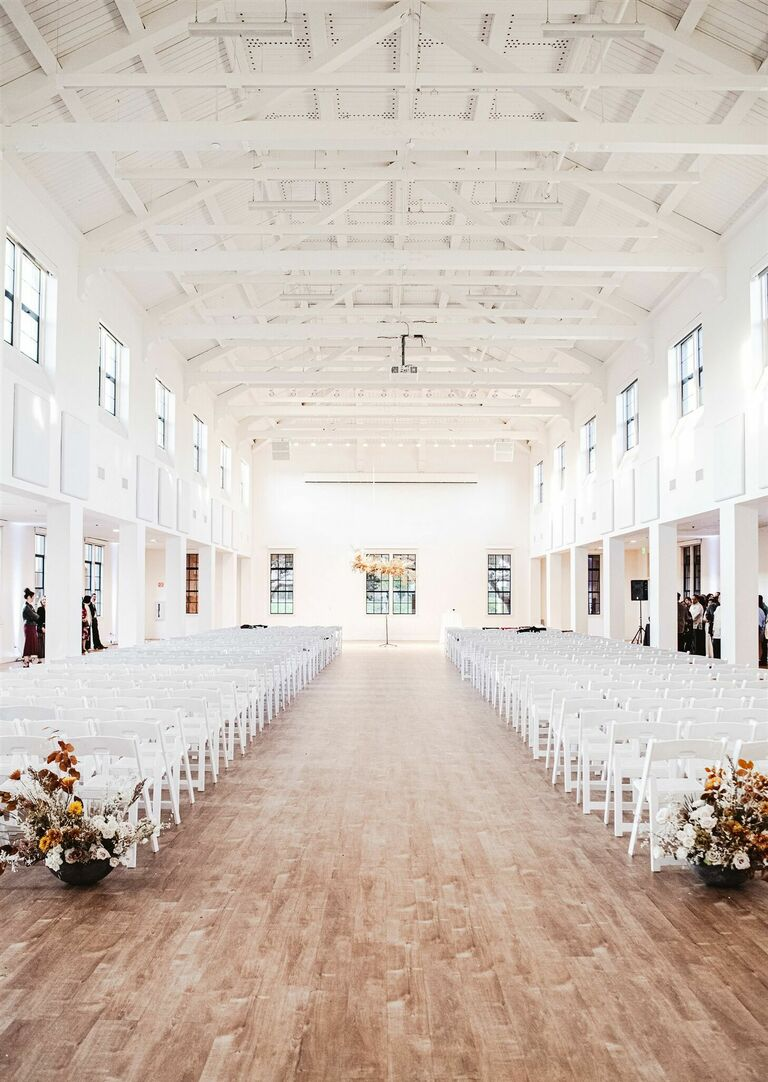 Ceremony in airy white warehouse venue