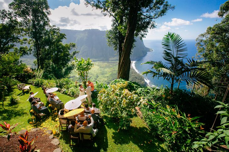 """""""We said our vows on the edge of a mountain with 360-degree views of the Pacific Ocean and the black-sand beach,"""" Charita says of their 21-person ceremony at Waipio Rim B & B in Honokaa, Hawaii"""