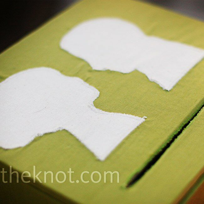 Melanie's brother and mom constructed a box for the cards that was covered in green and white fabric silhouettes.