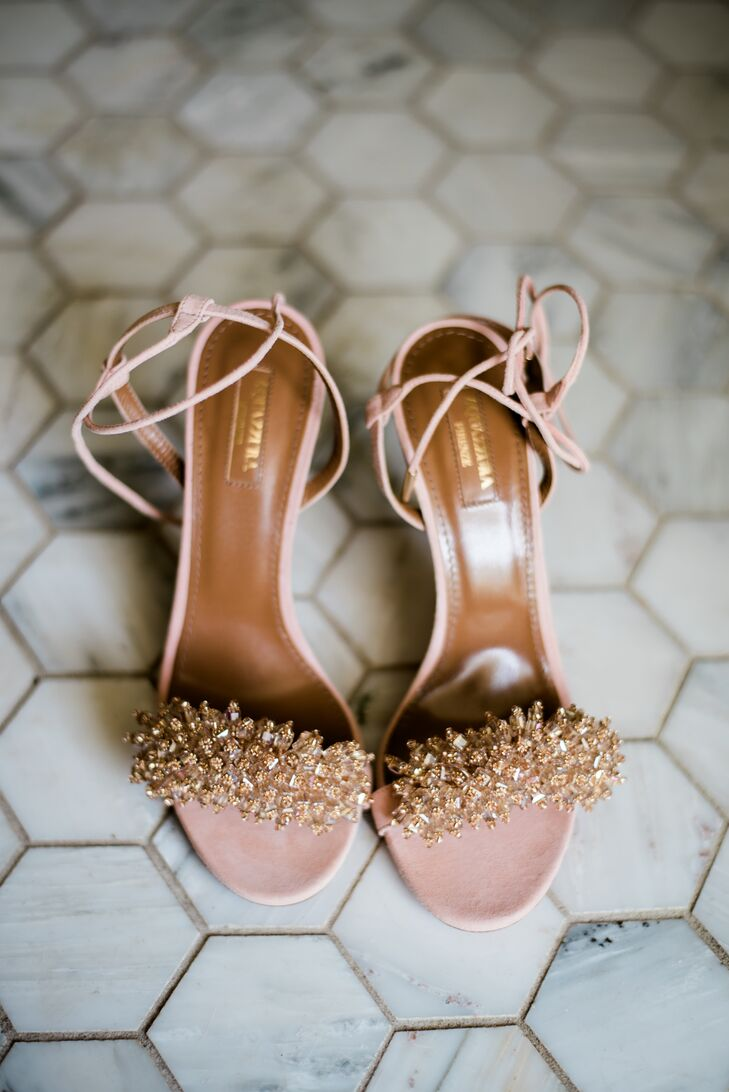 Mary accessorized her lace dress with a pair of Aquazzura crystal heels but changed into more comfortable shoes for dancing during the reception.
