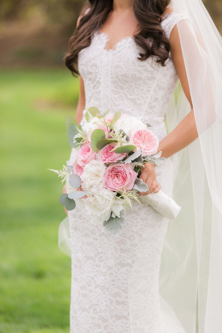 Nicole's bouquet was a full arrangement of white and pale pink garden roses.