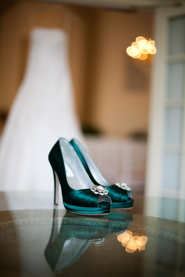 The bride designed her green heels through the Etsy shop Design Your Pedestal. For the reception, she switched into TOMS wedges.