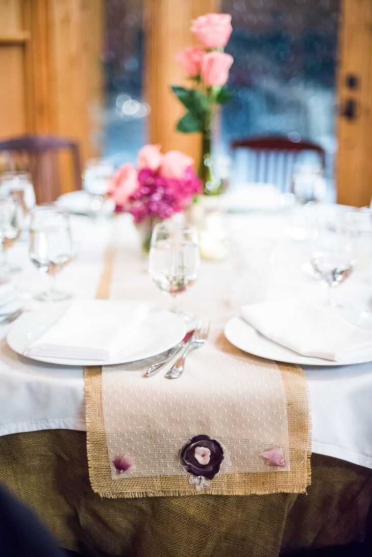 The reception tables were lined with burlap and tulle table runners accented with purple fabric flowers to match the bride's bouquet.