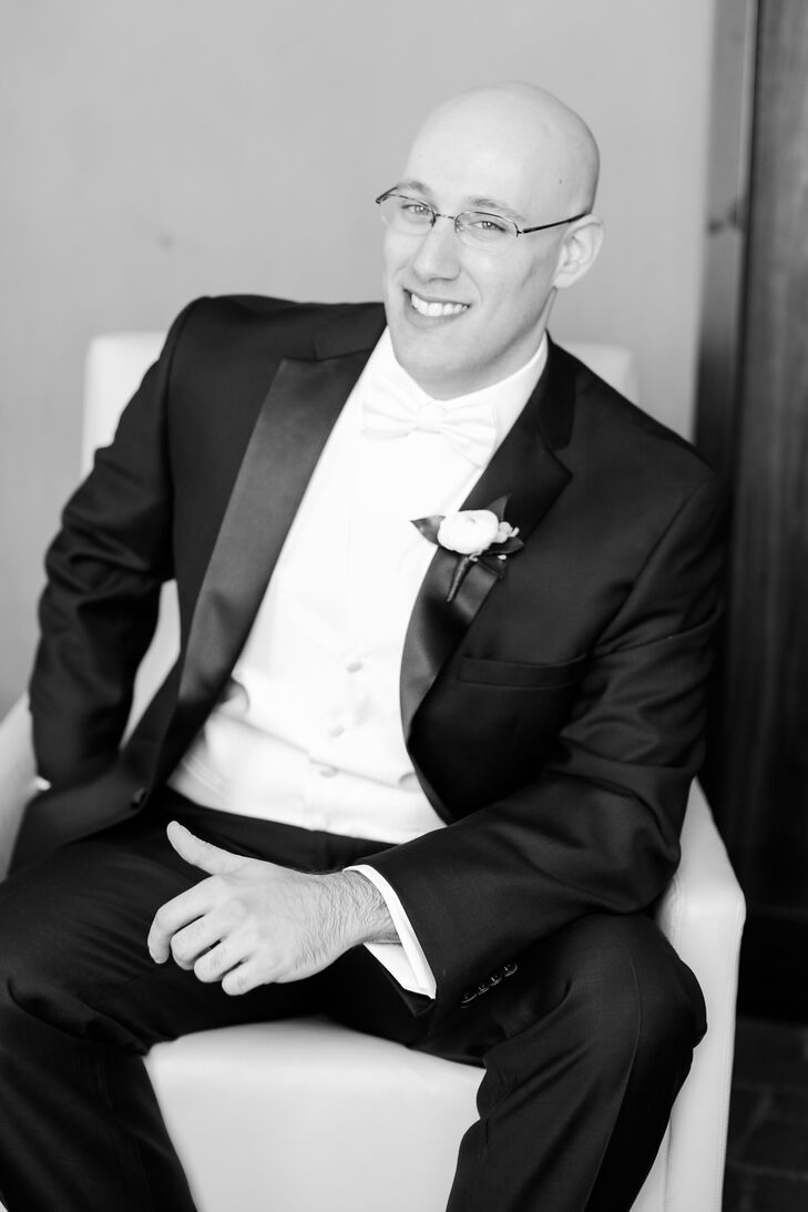 Jake wore a black tuxedo with a fly-front shirt, white vest and white bow tie on his wedding day.