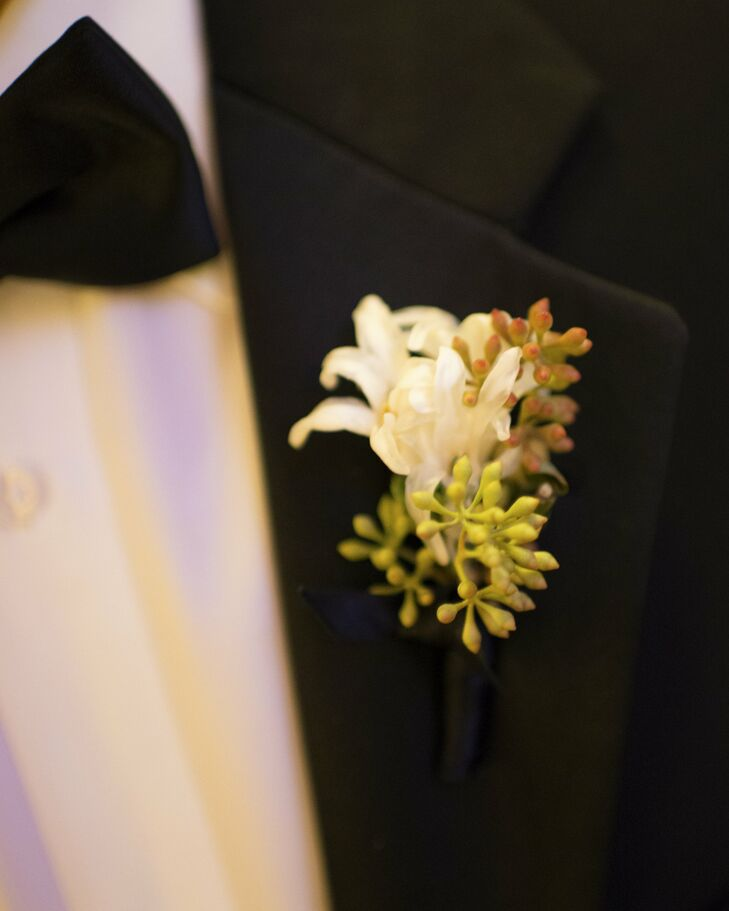 The men wore simple white blooms paired with seeded eucalyptus on their lapels.