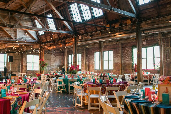 """Although they originally had their hearts set on a barn wedding in Hudson Valley, Jordy and Jared didn't want to miss the opportunity to share New York City with their out-of-town guests. """"When we found the Greenpoint Loft, we knew it was perfect because it had gorgeous architectural details and high rafters that reminded us of a barn, but was smack in the middle of Brooklyn and came complete with insane views of the Manhattan skyline,"""" explains Jordy. """"It was the only venue we visited, and we booked it three months before it even opened for events."""""""