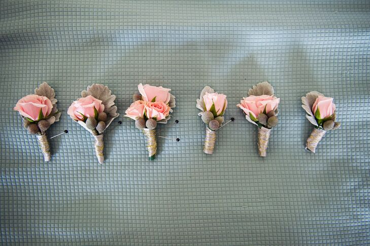The groom and groomsmen wore blush roses with silver brunia balls and lamb's ear for their boutonnieres.