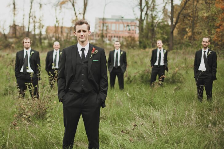 """The groomsmen wore black suits with black ties. """"It was an easy option since most of them already had suits,"""" the bride says. """"Johnathan wore the same, but added a black vest and a green pocket square."""""""