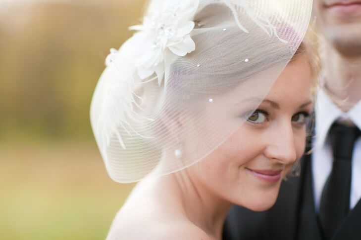 Following the ceremony, Erica replaced her veil with a bridal headpiece from the boutique Treat's Bridal Shoppe in Plymouth, Indiana.