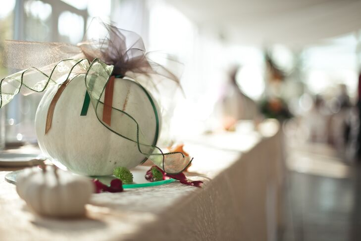 The bride and groom used white pumpkins instead of orange for the reception decor because it felt more appropriate for a wedding.