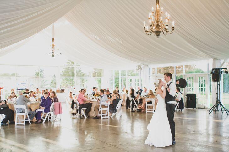 Bride and Groom's First Dance Under Chandelier