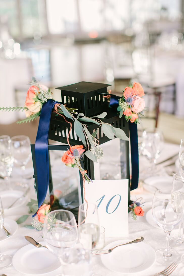 Lantern Centerpieces and Coral Blooms Tied with Blue Ribbon
