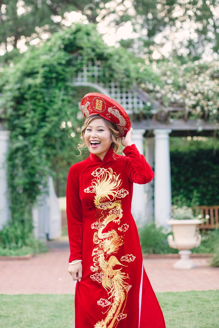 "Christina then changed into a traditional silk Vietnamese dress, pants and hat called an ao dai that her aunt had custom-made for her in Vietnam. ""My outfits were red and gold to represent luck and prosperity, and the embroidered dragon symbolized wealth,"" Christina says."