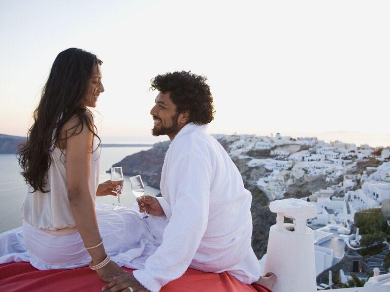 Couple toasting champagne on honeymoon