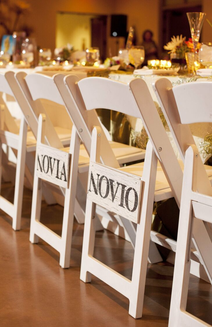 Novia and novio signs, meaning bride and groom in Spanish, were displayed on the back of Nichole and JJ's reception chairs.