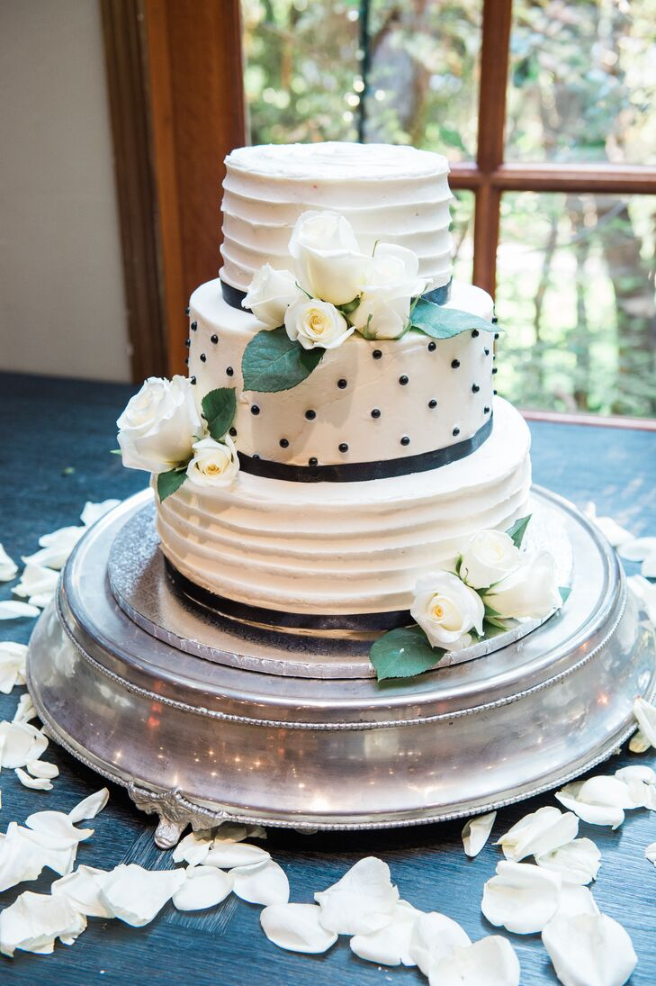 "Crumb Fairy Bakery in Los Angeles, California, owned by Monika and Virpi's friend, created their refined, three-tier dessert. ""For the cake-cutting ceremony, we used the heirloom cake-cutting set used by Monika's parents when they were married 43 years ago,"" Virpi says."