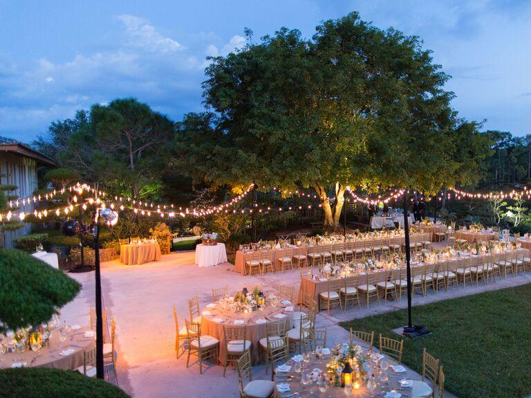 Candlelit string light wedding reception