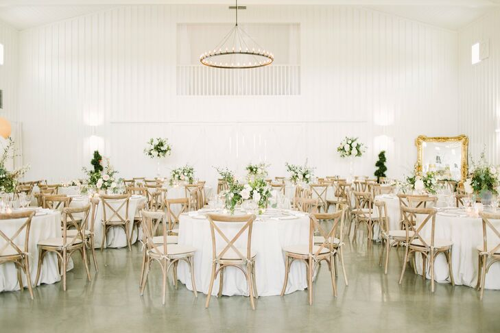 Bright White Reception Space with Simple Flower Arrangements and Cross-Back Chairs