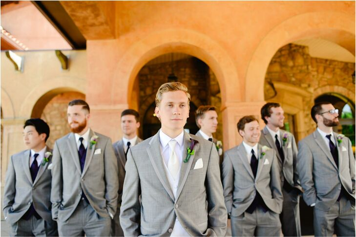 Groomsmen in Gray Tuxes with Purple Boutonnieres