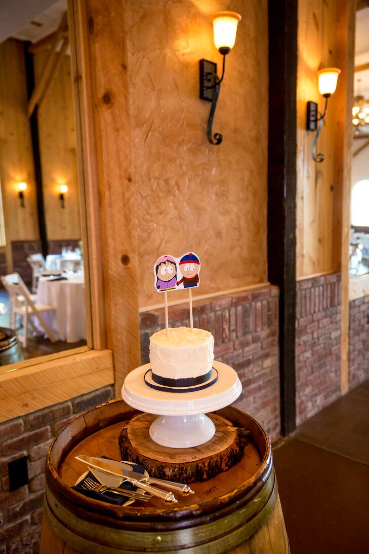 """For dessert, Kerry and Billy had a personal red velvet cake from Happy Cakes Bakeshop for the traditional cake cutting. Kerry drew and painted the cake topper herself. It was Stan and Wendy from """"South Park,"""" one of the couple's favorite TV shows."""