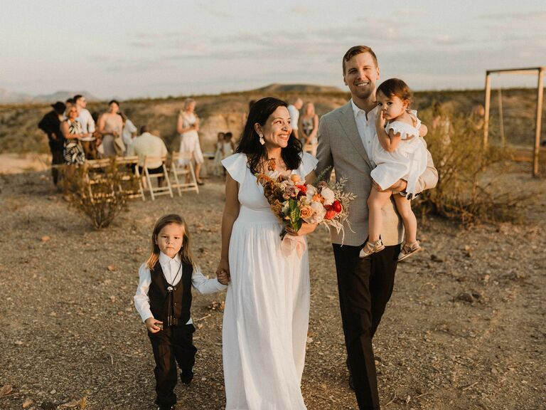 Couple at wedding with children