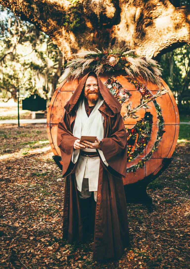 Officiant in brown robe
