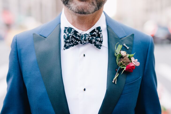 Jason wore a custom tuxedo in a deep navy color for the early-fall fete which he paired with a floral bow tie, polka-dot socks and a dog-bone-shaped lapel pin in honor of the couple's three dogs at home in Scottsdale, Arizona. For a pop of color, Kat Hyppolite of Kat Flower created a textured boutonniere filled with roses, hydrangeas, eucalyptus and more for Jason to wear on his lapel.