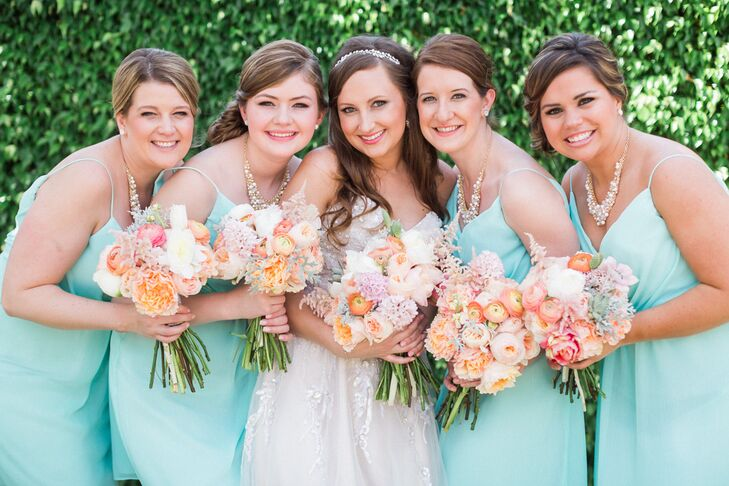 While she didn't have a specific flower preference, Stephanie knew she wanted citrus-inspired colors for the bridesmaid bouquets. Each arrangement was a smaller version of Stephanie's, with a mix of orange ranunculus, peach peonies, pink astilbes, succulents, dusty miller, white peonies and pink astilbes. The cute combination had a soft nod to their theme while still maintaining a chic palette.