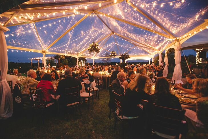 Though the forecast called for precipitation on the day of the celebration, it didn't rain a drop and the reception went off without a hitch beneath a clear-top tent on the grounds of The Wild Onion Ranch.