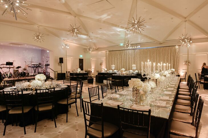 Large mirrored tables and black chiavari chairs gave the reception a sleek and sophisticated look.
