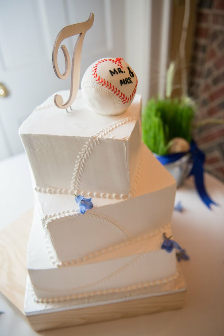 The couple's three-tiered buttercream cake featured piping that resembled the stitching on a baseball. The cake was topped by a baseball with heart-shaped stitching that read Mr. & Mrs and a silver T for the couple's last name.