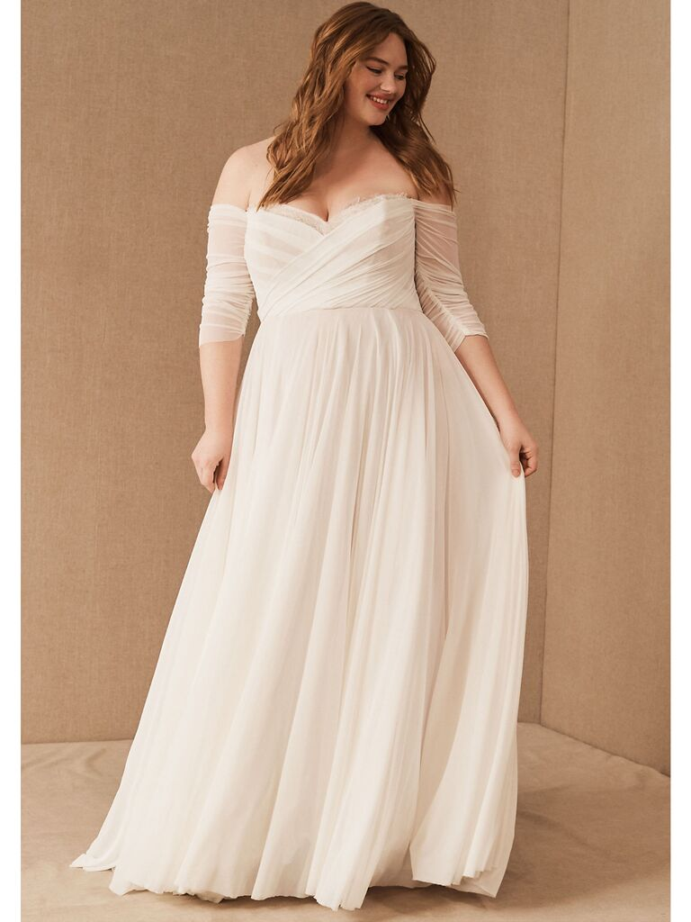 Off-the-shoulder plus size ball gown with shirred bodice and sheer sleeves