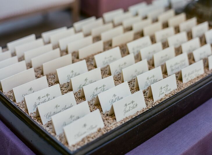 The names of each guest were hand-calligraphed on each escort card in sage green ink.