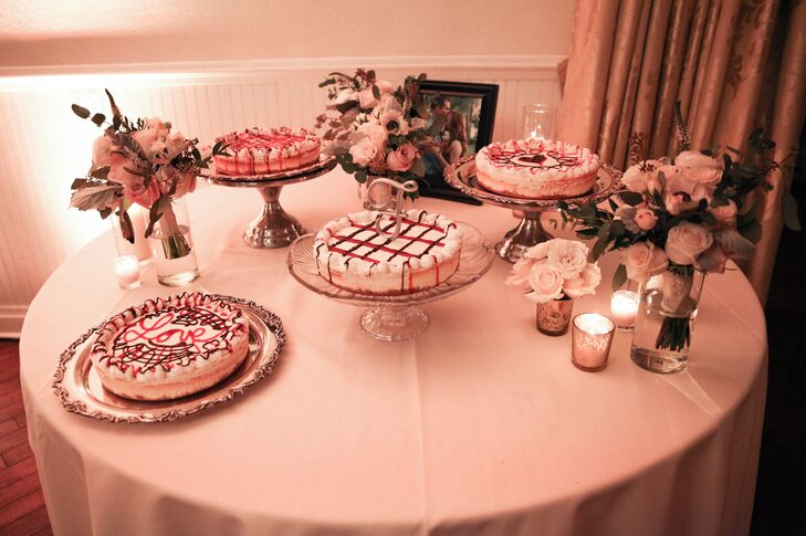 """In lieu of a traditional wedding cake, Emily and Mike chose something a little more whimsical for dessert. Their 122 guests were treated to four different cheesecakes accented with red checkerboard, a """"Love"""" topper and criss-cross designs. """"It turned out to be more cost effective, beautiful and delicious to do it that way,"""" Emily says."""