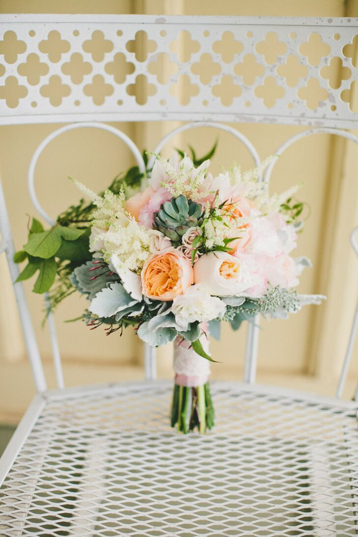 The florists at Daisy Rose took the lead on Molly and Patrick's wedding day flowers, creating romantic, summery arrangements in shades of cream, peach, blush and green to complement Beltane Ranch's picturesque setting. For Molly's bouquet, they went for a look of wild romance, pulling together a textured bundle of garden roses, dahlias, peonies, dusty miller, astilbes, succulents and greenery, which they finished with pale pink ribbon and lace.