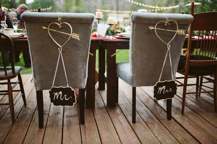 """At the dinner reception at Long Hollow Ranch in Sisters, Oregon, plush seats were adorned with """"Mr."""" and """"Mrs."""" signs."""