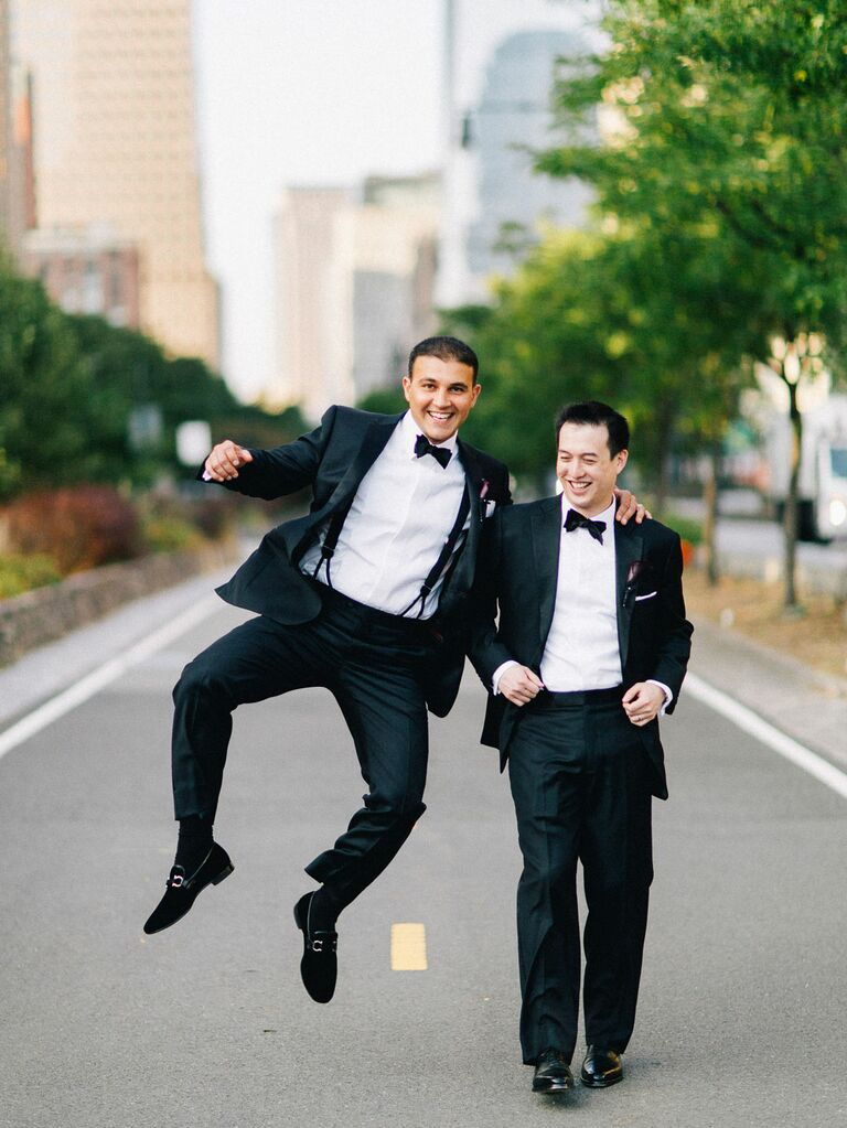 Groom posing for photo with his best man