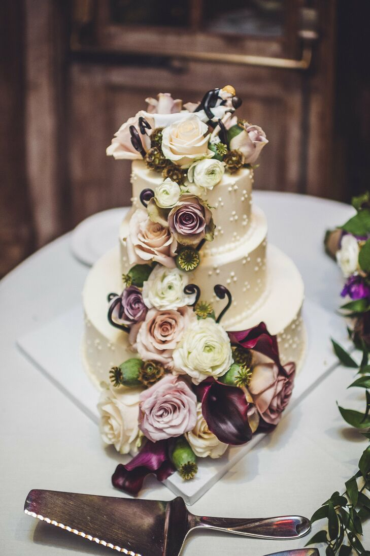 The couple chose a three-tier vanilla pound cake with buttercream frosting, decorated with a Swiss-dot pattern and a fun cake topper.