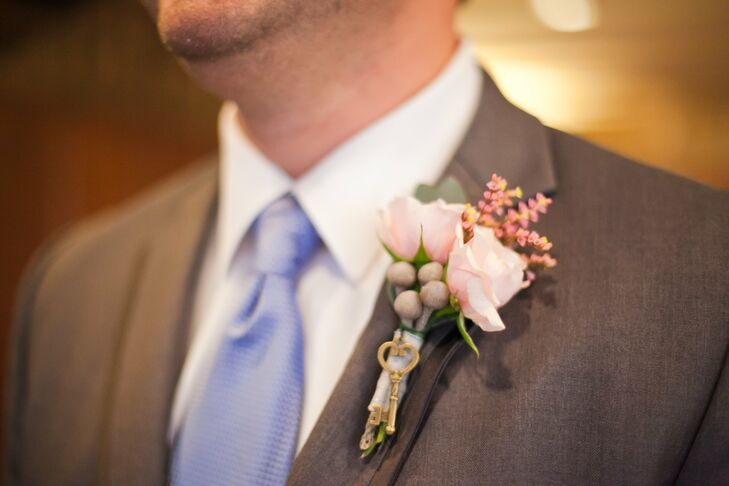 A small, antique key was tied to the groom's pink rose boutonniere.