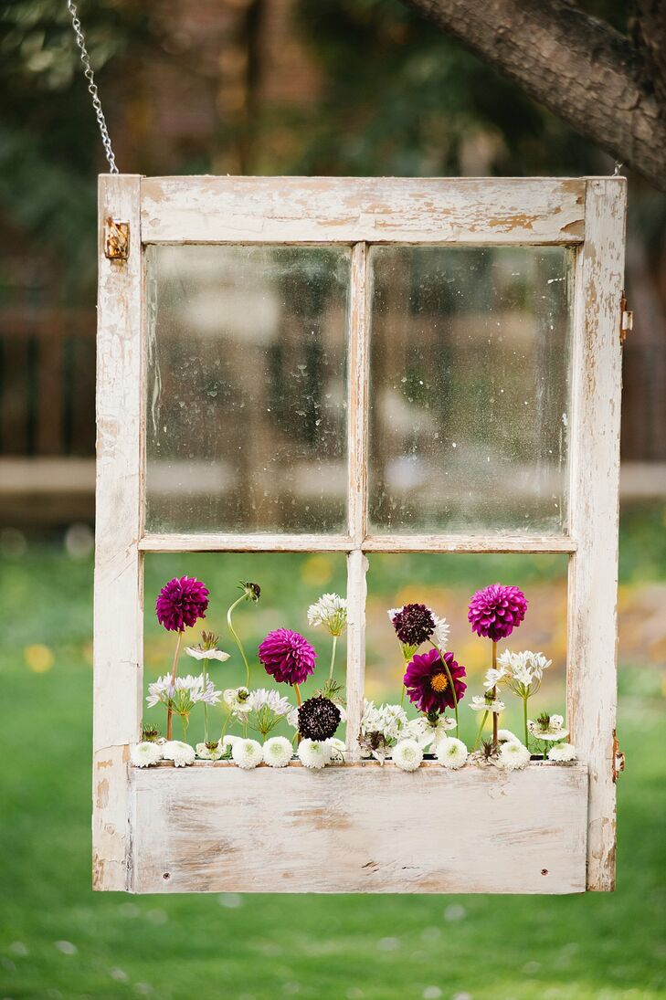 Dahlias and scabiosas in fuchsia, white and dark purple were planted in the hanging window boxes at the ceremony.