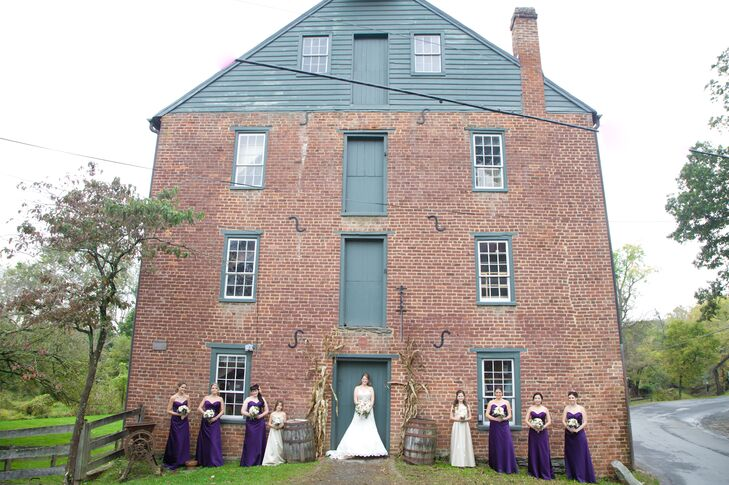 The bridesmaids wore strapless, floor-length dresses in deep purple that were perfect for the fall weather and the rustic setting.